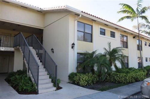 Photo of 1566 Lake Crystal Dr #D, West Palm Beach, FL 33411 (MLS # A10901285)