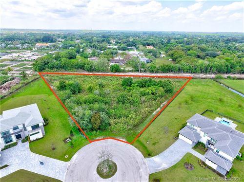 Photo of 17818 Rolling Oaks Estates Dr, Southwest Ranches, FL 33331 (MLS # A11033285)