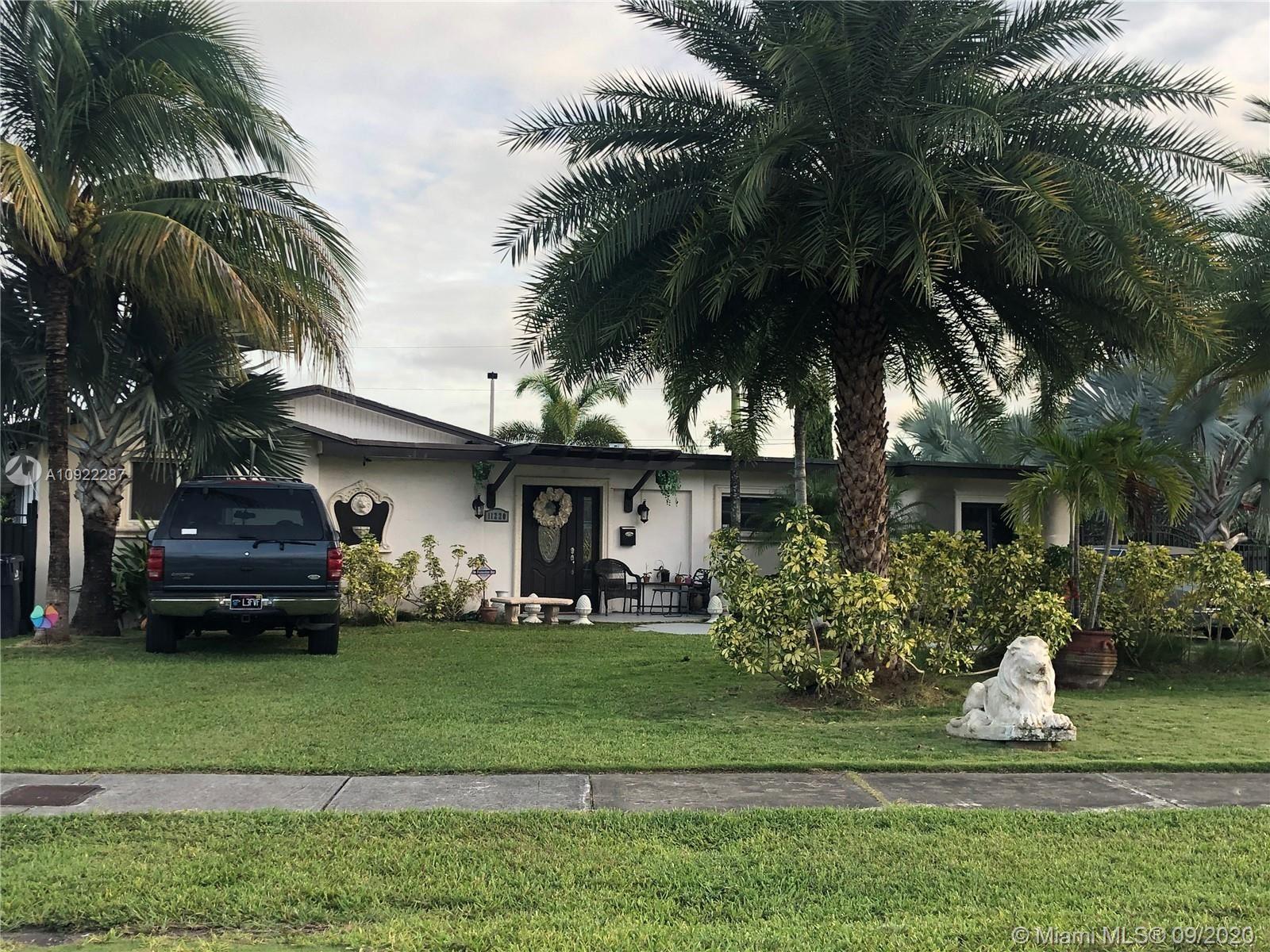 Photo of 11220 SW 181st Ter, Miami, FL 33157 (MLS # A10922287)