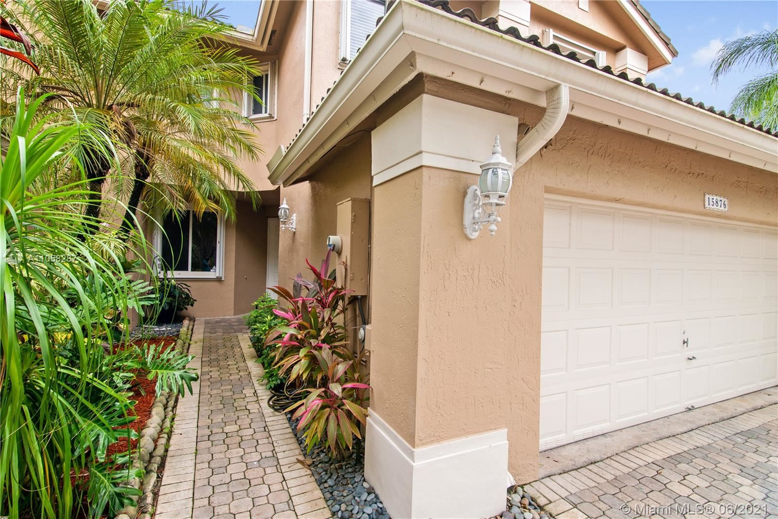 Photo of 15876 SW 12th St #15876, Pembroke Pines, FL 33027 (MLS # A11058287)