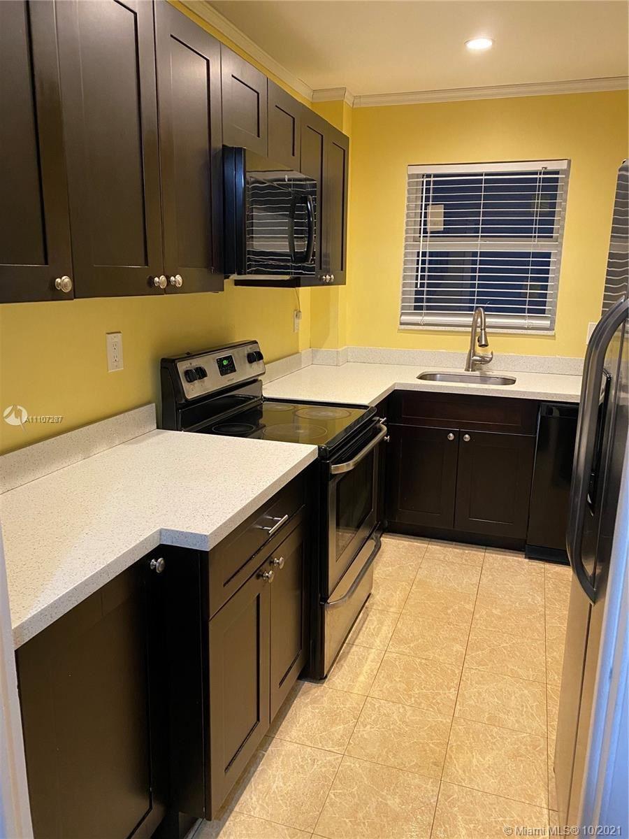 Photo of 541 Blue Heron Dr #304, Hallandale Beach, FL 33009 (MLS # A11107287)