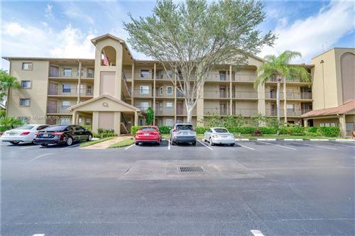 Photo of 1400 SW 124th Ter #203Q, Pembroke Pines, FL 33027 (MLS # A11114289)