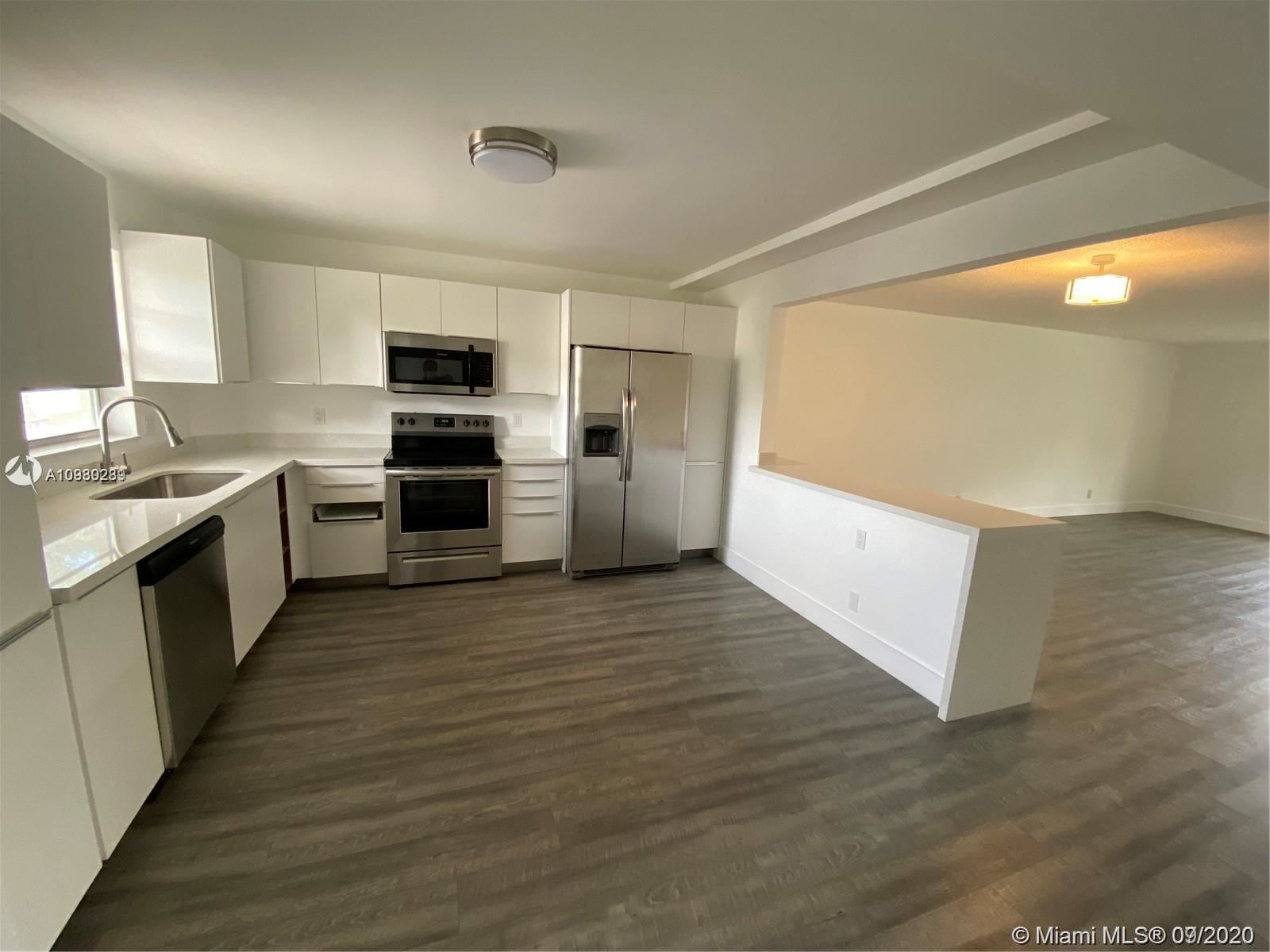 Photo of 271 S Hollybrook Dr #203, Pembroke Pines, FL 33025 (MLS # A10930289)
