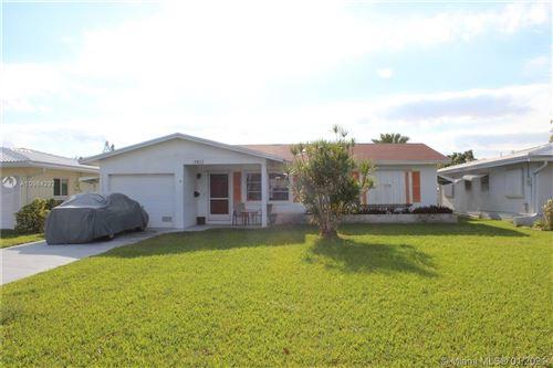 Photo of 5813 NW 70th Ave, Tamarac, FL 33321 (MLS # A10984292)