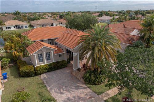 Photo of 16443 NW 13th St, Pembroke Pines, FL 33028 (MLS # A11027292)