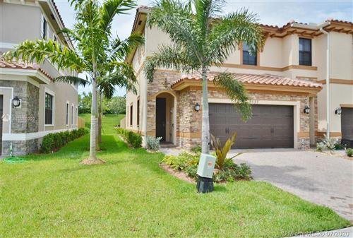 Photo of 9598 S Town Parc Cir S, Parkland, FL 33076 (MLS # A10886293)