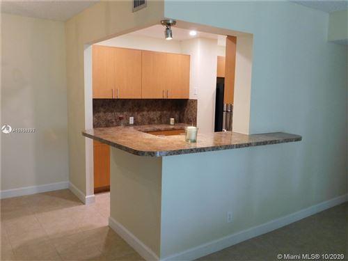 Photo of 3821 Environ Blvd #105, Lauderhill, FL 33319 (MLS # A10938293)