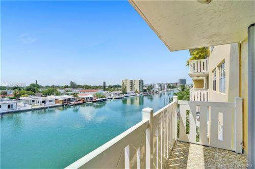 Photo of 7900 Tatum Waterway Dr #405, Miami Beach, FL 33141 (MLS # A10892295)