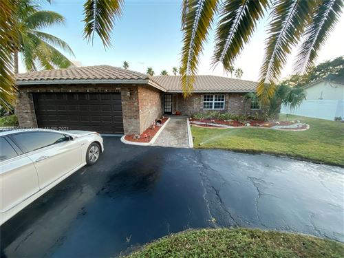 Photo of 8940 NW 2nd St, Coral Springs, FL 33071 (MLS # A11113298)