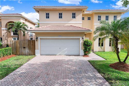 Photo of 12956 SW 136th Ter, Miami, FL 33186 (MLS # A10864299)