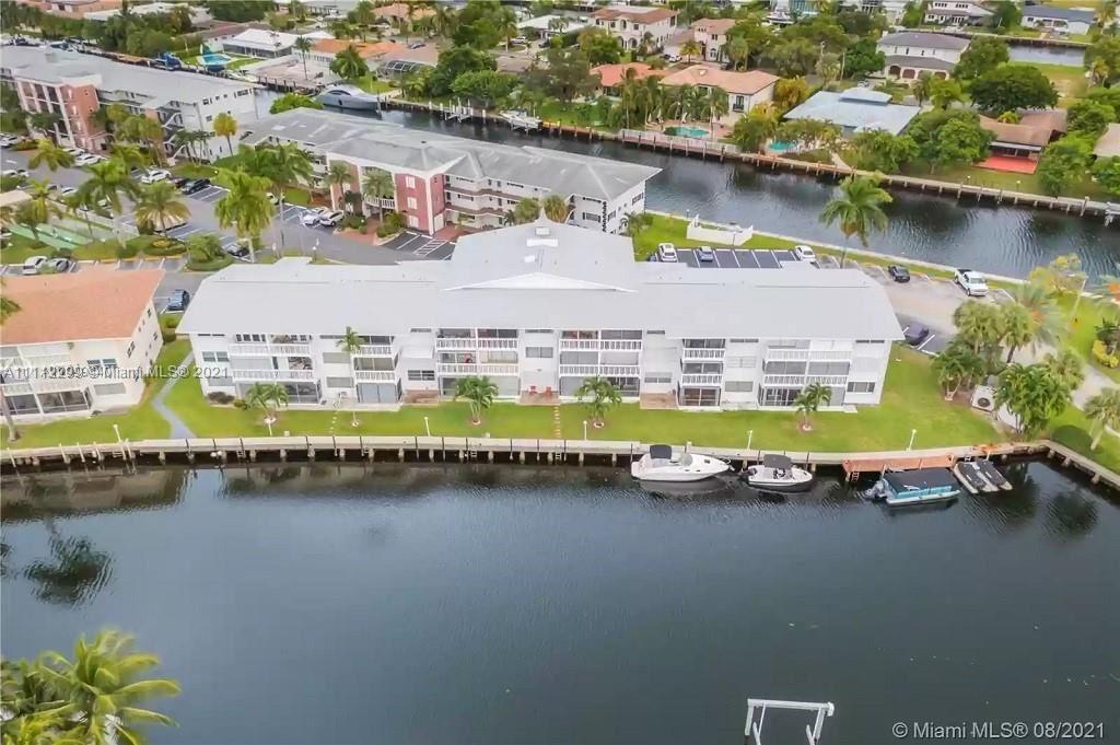 Photo of 470 Paradise Isle Blvd #308, Hallandale Beach, FL 33009 (MLS # A11112299)