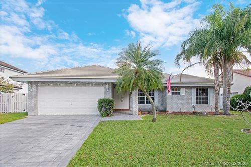 Photo of 720 Blue Ridge Way, Davie, FL 33325 (MLS # A10840301)