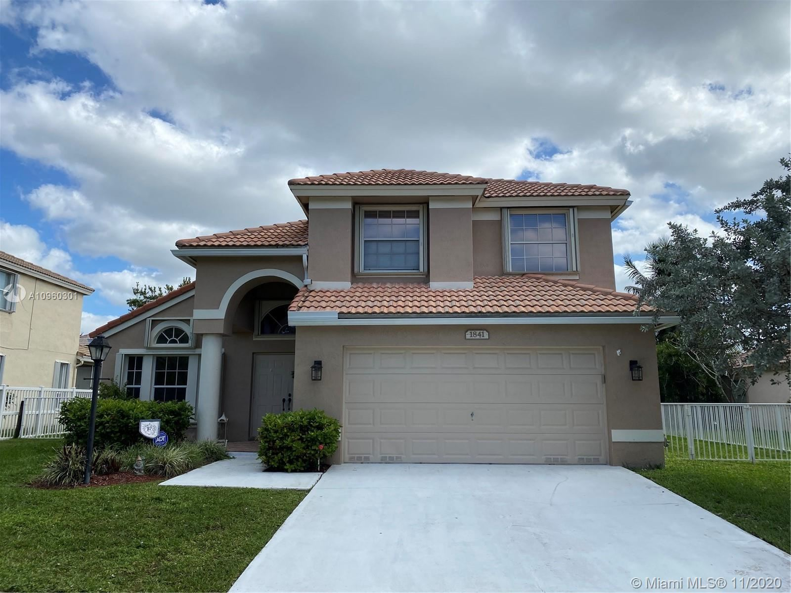 Photo of 1841 NW 131st Ave, Pembroke Pines, FL 33028 (MLS # A10960301)
