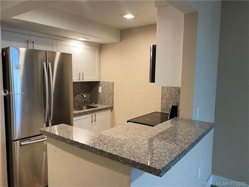 Photo of 449 Swallow Dr #9, Miami Springs, FL 33166 (MLS # A10956304)