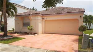 Photo of 1433 NW 153rd Ave, Pembroke Pines, FL 33028 (MLS # A10673305)