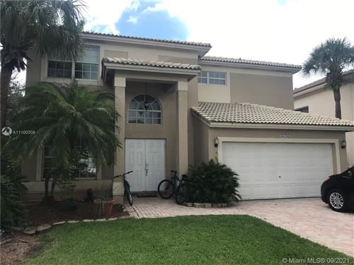 Photo of 16785 NW 12th Ct, Pembroke Pines, FL 33028 (MLS # A11100308)