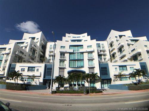 Photo of 7600 Collins Ave #701, Miami Beach, FL 33141 (MLS # A10829310)