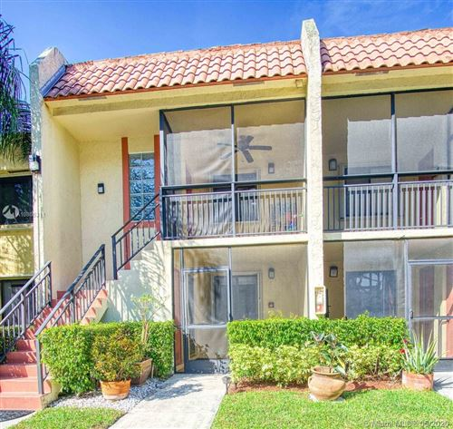 Photo of 402 Lakeview Dr #202, Weston, FL 33326 (MLS # A10805311)