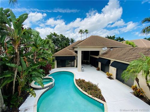 Photo of 2447 NW 62nd St, Boca Raton, FL 33496 (MLS # A10875311)