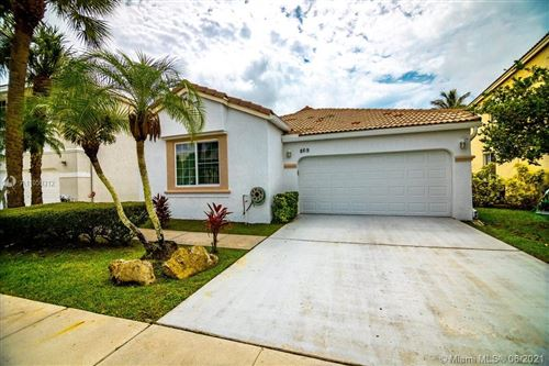 Photo of 869 NW 156th Ave, Pembroke Pines, FL 33028 (MLS # A11059312)