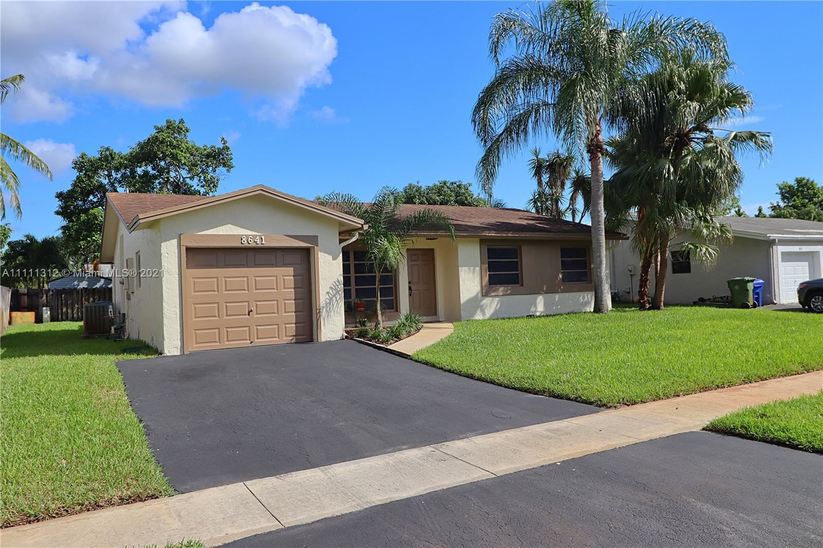 Photo of 8641 NW 8th St, Pembroke Pines, FL 33024 (MLS # A11111312)