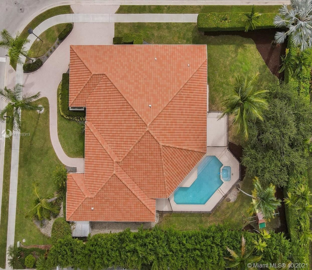 Photo of 701 NW 100th Ter, Plantation, FL 33324 (MLS # A11110313)
