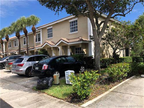 Photo of 12201 SW 6th St #0, Pembroke Pines, FL 33025 (MLS # A10886314)