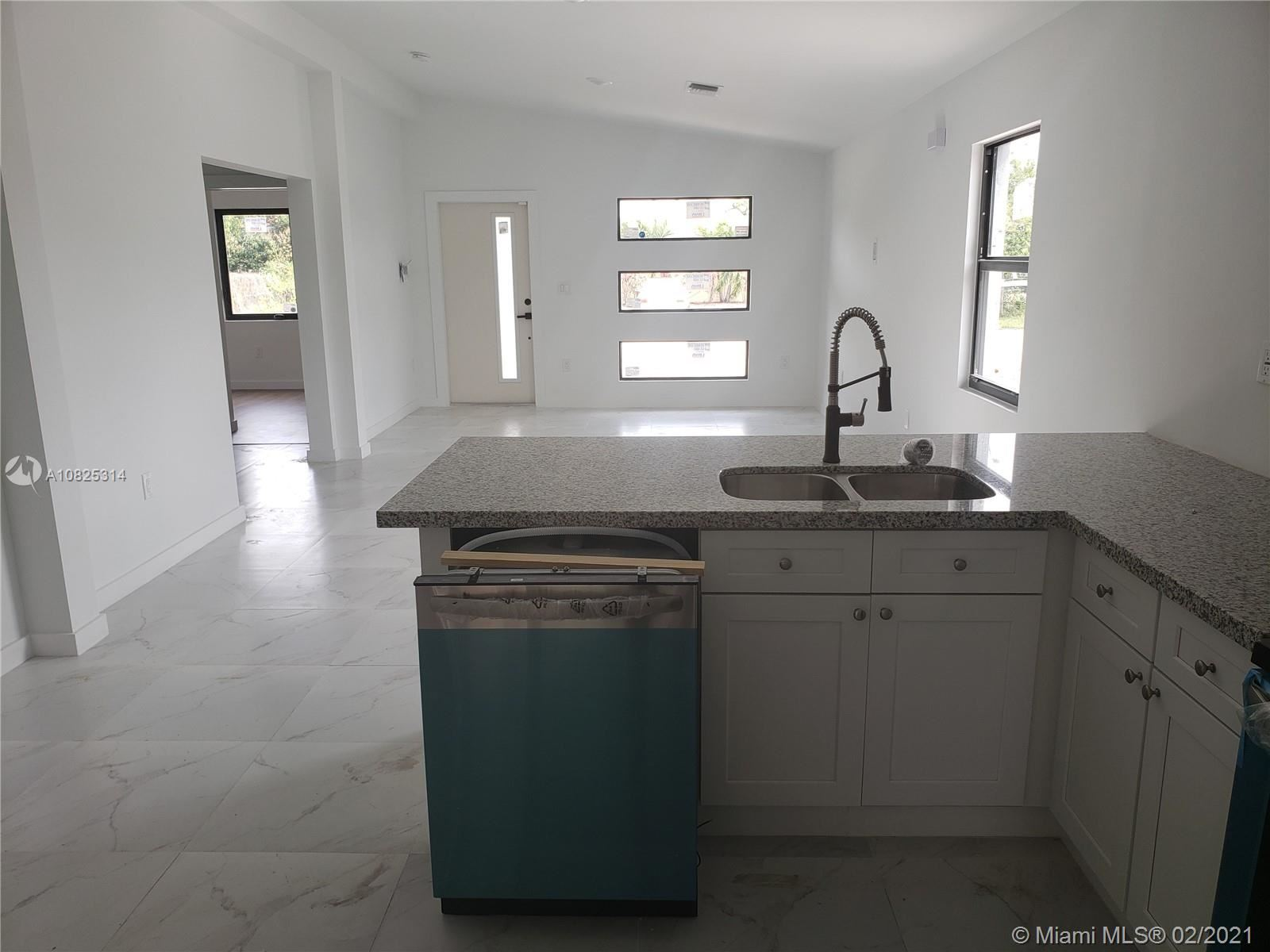 Photo of 18 Nw Ter, Oakland Park, FL 33311 (MLS # A10825314)