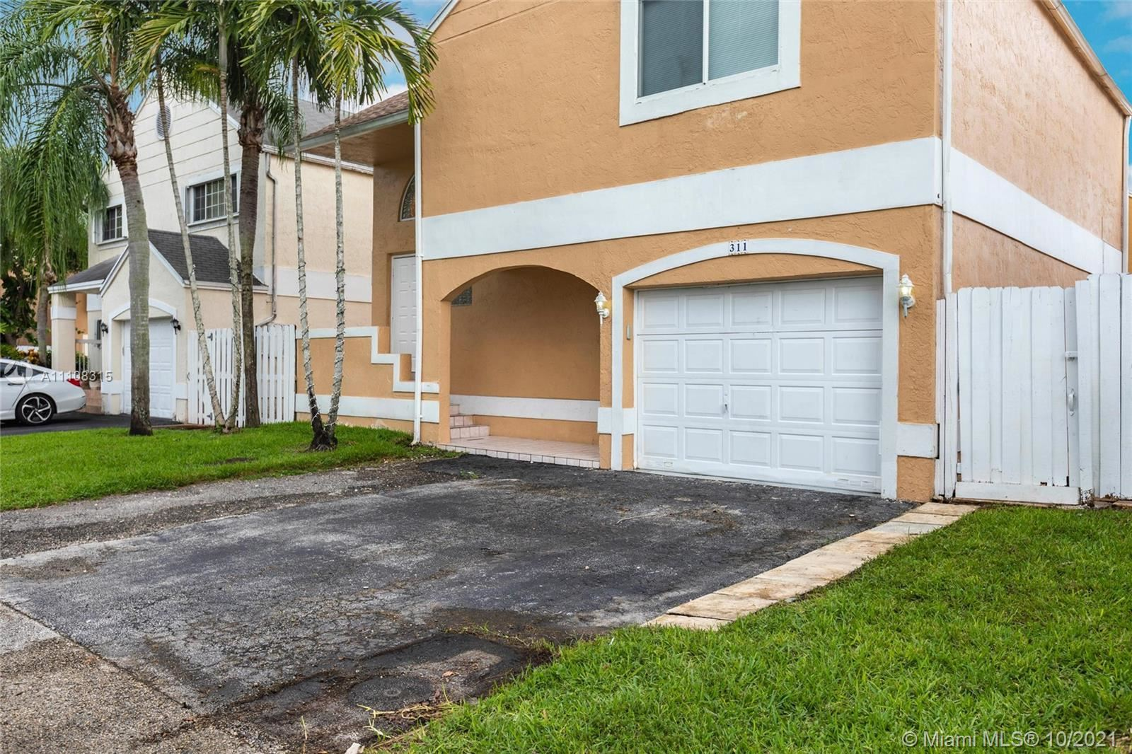 Photo of 311 NW 102 Ave, Pembroke Pines, FL 33026 (MLS # A11108315)