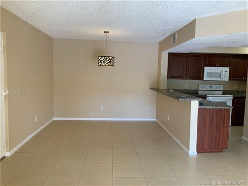 Photo of 18850 NW 57th Ave #203, Hialeah, FL 33015 (MLS # A11041316)