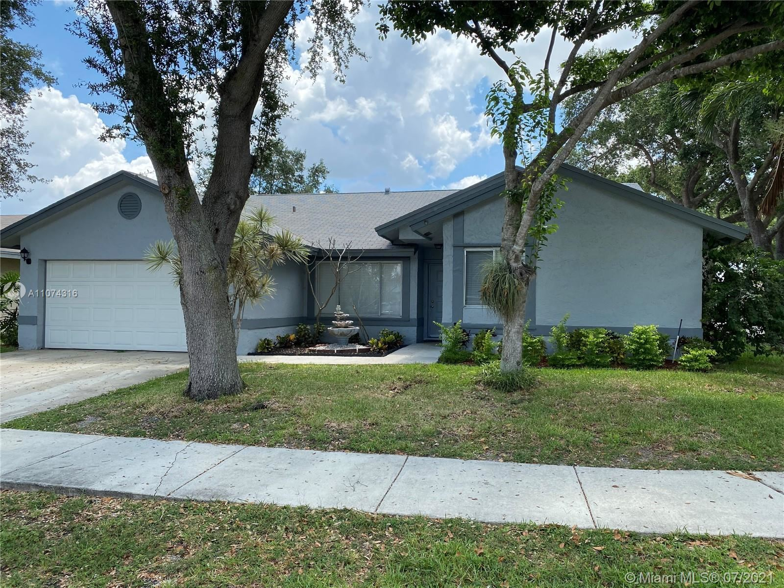Photo of 5800 NW 37th Ave, Coconut Creek, FL 33073 (MLS # A11074316)
