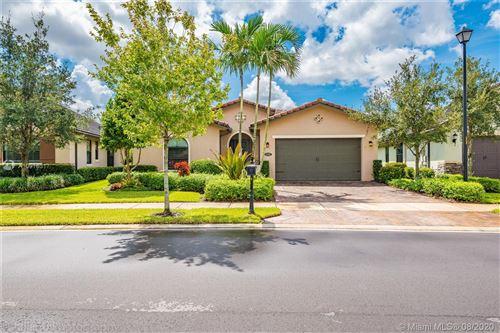 Photo of 11300 Carrington Ave, Parkland, FL 33076 (MLS # A10916317)