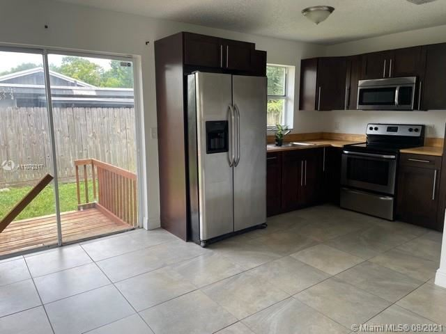 Photo of 1990 SW 9th St #1-2, Fort Lauderdale, FL 33312 (MLS # A11075317)