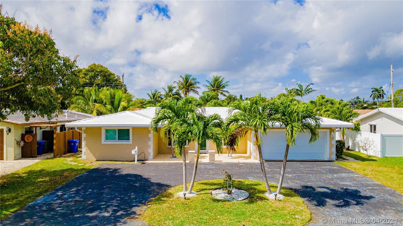 Photo of 5641 NE 16th Ave, Fort Lauderdale, FL 33334 (MLS # A11031319)