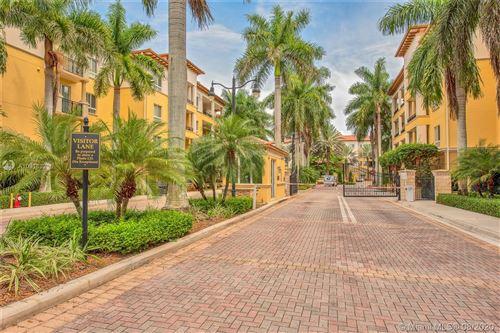 Foto de inmueble con direccion 16102 Emerald Estates Dr #303 Weston FL 33331 con MLS A10918321