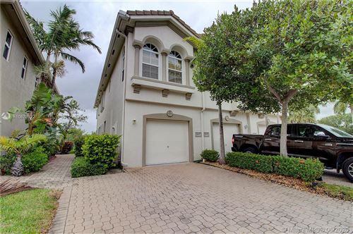 Photo of 3047 S Laurel Ridge Cir #3037, Riviera Beach, FL 33404 (MLS # A10873322)