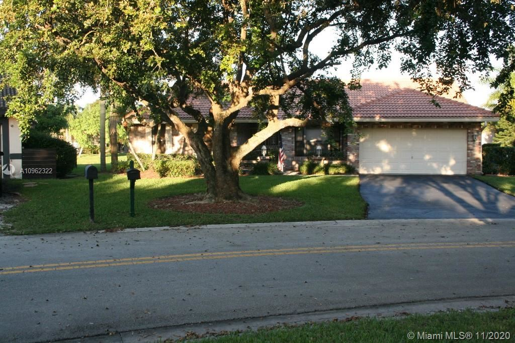 Photo of 10775 NW 5th Pl, Coral Springs, FL 33071 (MLS # A10962322)