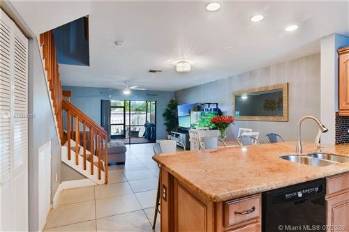 Photo of 117 NW 106th Ave #117, Pembroke Pines, FL 33026 (MLS # A10886323)
