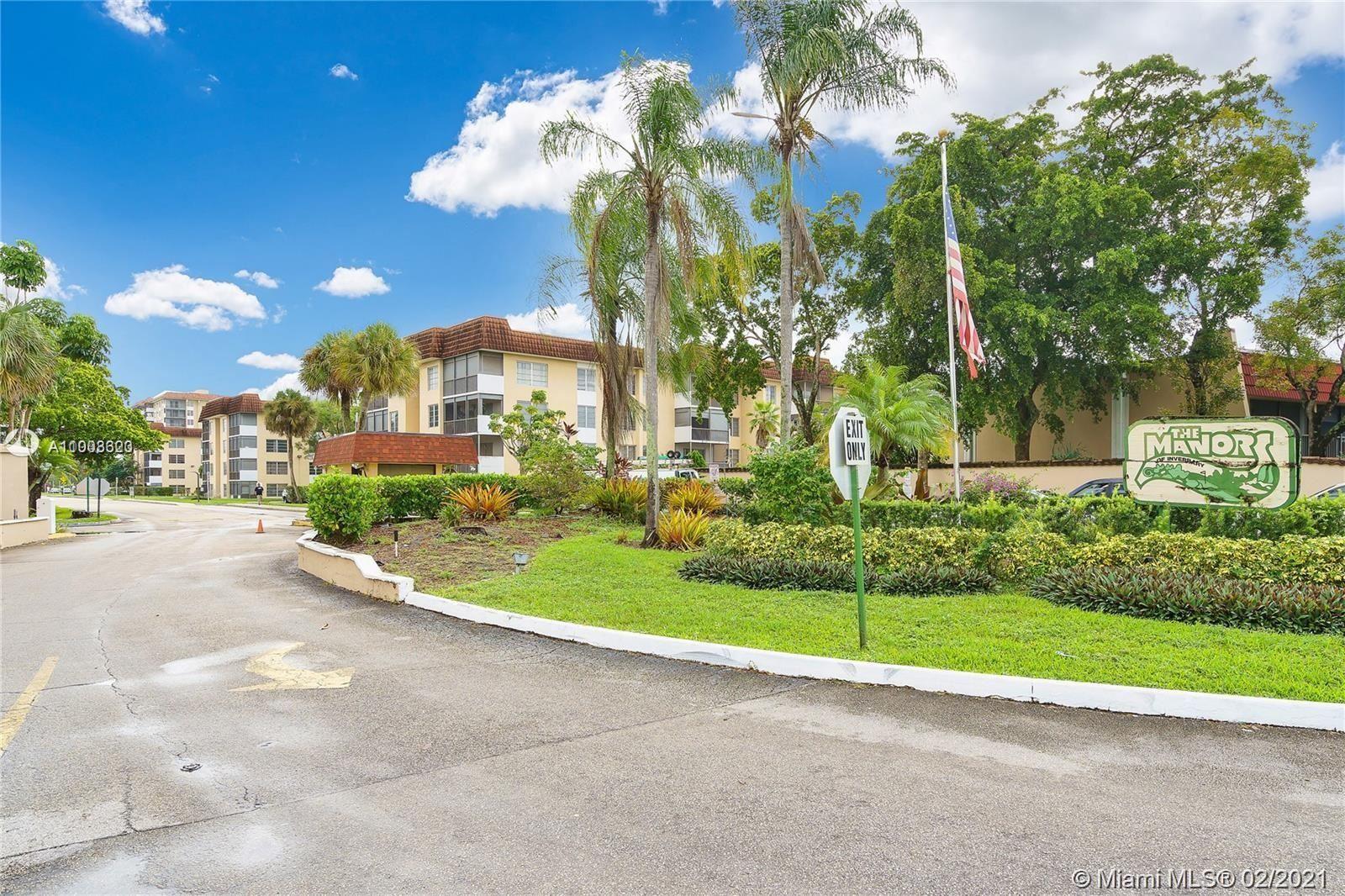 Photo of 3978 Inverrary Dr #D4, Lauderhill, FL 33319 (MLS # A11003323)