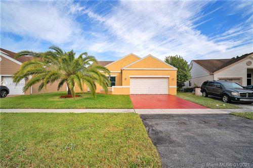 Photo of 1121 SW 87th Avenue, Pembroke Pines, FL 33025 (MLS # A10983324)