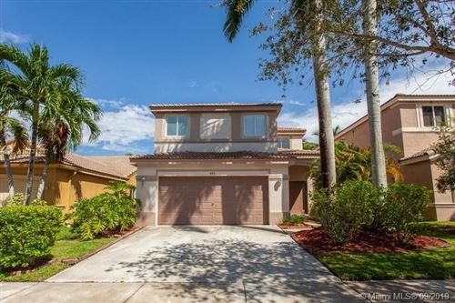 Photo of 445 Conservation Dr, Weston, FL 33327 (MLS # A10731327)