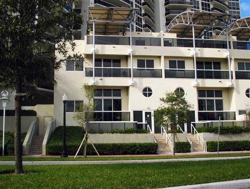 Photo of 400 Alton Rd #TH-1A, Miami Beach, FL 33139 (MLS # A10840327)