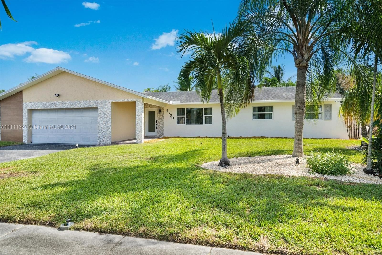 Photo of 6730 NW 26th Ter, Fort Lauderdale, FL 33309 (MLS # A11111327)