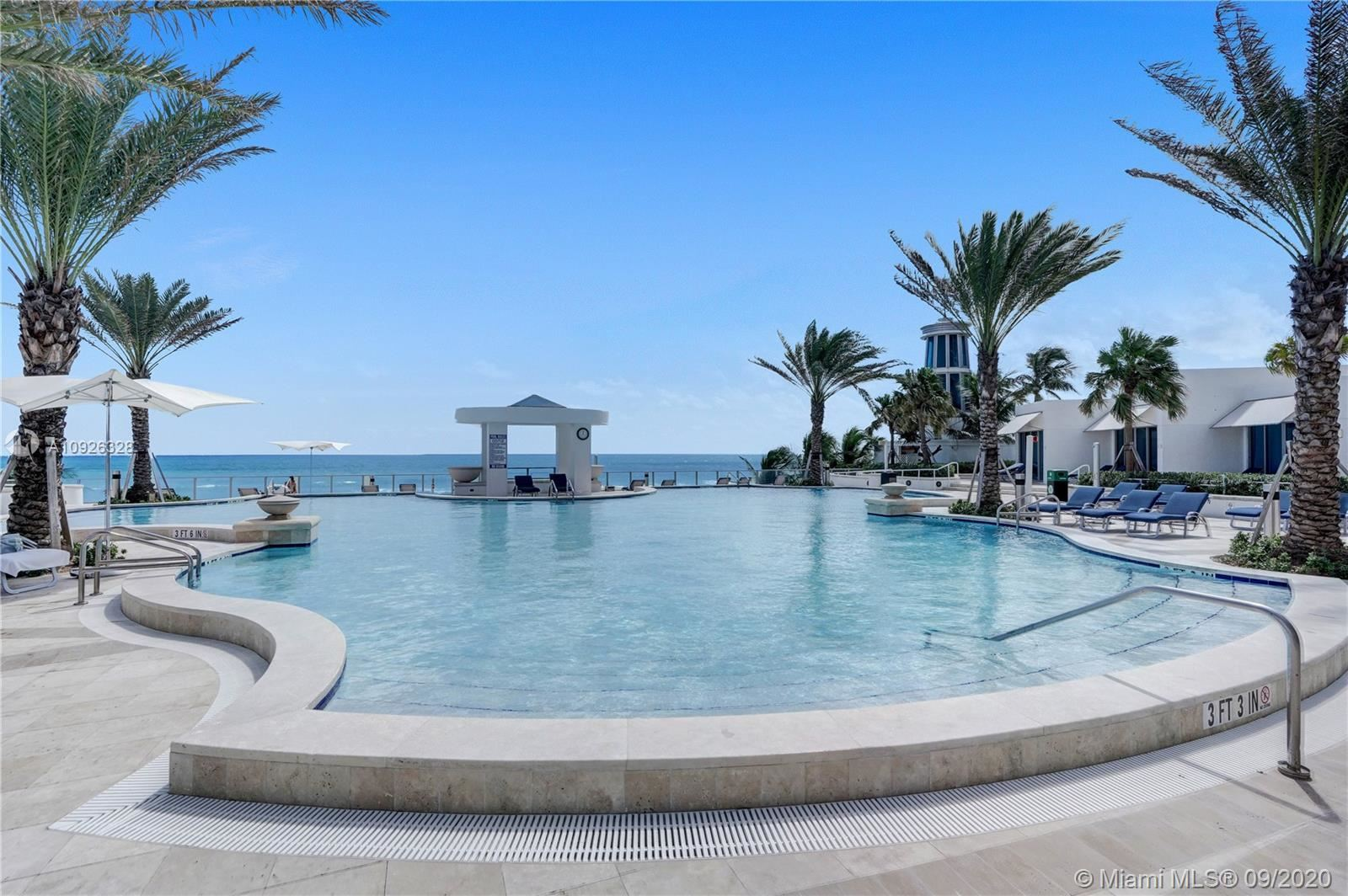 Photo of 3101 S Ocean Dr #1907, Hollywood, FL 33019 (MLS # A10926328)