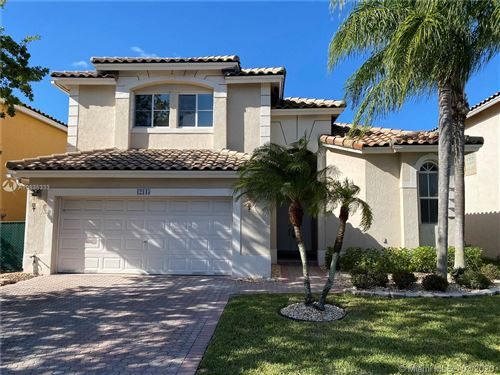 Photo of 12143 NW 46th St, Coral Springs, FL 33076 (MLS # A10835333)