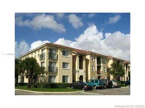 Photo of 2427 Centergate Dr #103, Miramar, FL 33025 (MLS # A10964334)