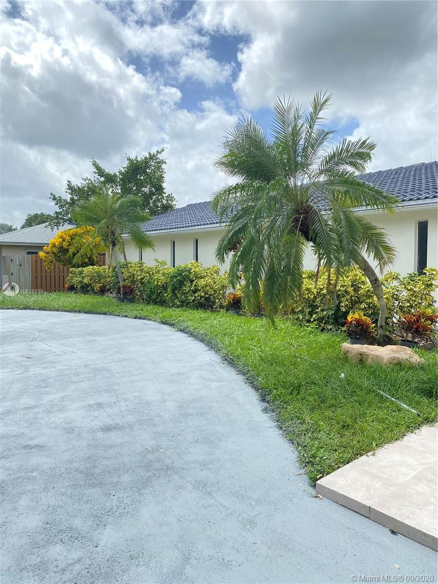 Photo of 1801 SW 72nd Ave, Plantation, FL 33317 (MLS # A10928335)
