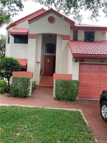 Photo of 7681 Lexington Club Blvd #C, Delray Beach, FL 33446 (MLS # A10862337)