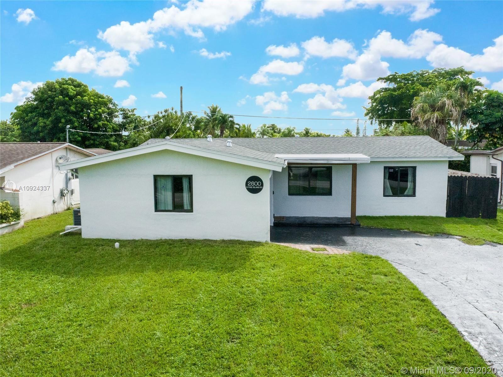 Photo of 2600 N Pine Island Rd, Sunrise, FL 33322 (MLS # A10924337)