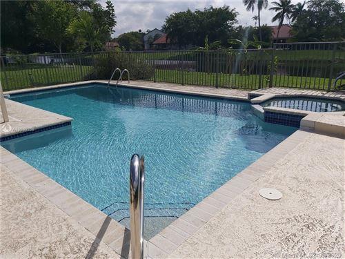 Photo of 21181 White Oak Ave, Boca Raton, FL 33428 (MLS # A10880338)